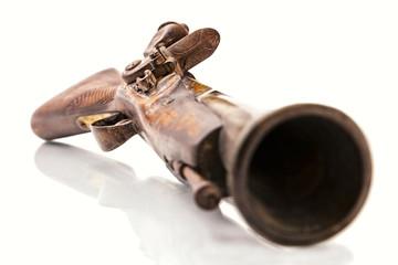 Antique flintlock blunderbuss pistol detail, on white
