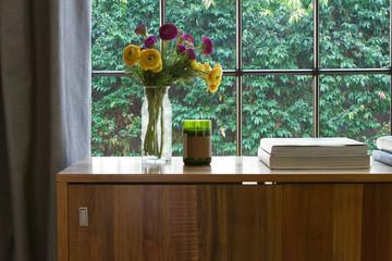 Warm interior looking onto a green hedge garden outlook
