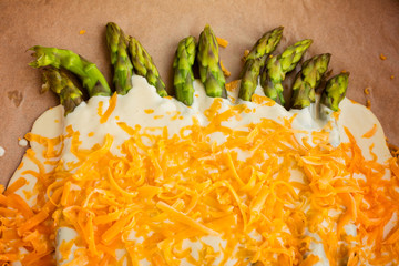Creamy baked asparagus and aged cheddar redy for oven