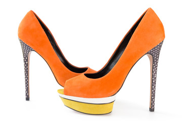 Pare of orange and yellow shoes isolated on white background