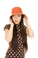 Adorable Asian American teen girl wearing polka dot dress