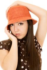 Pretty Asian American teen girl model wearing an orange hat