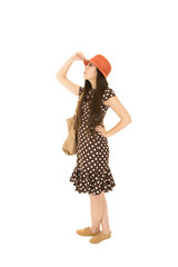 Fun teen girl portrait wearing a brown polka dot dress and an or