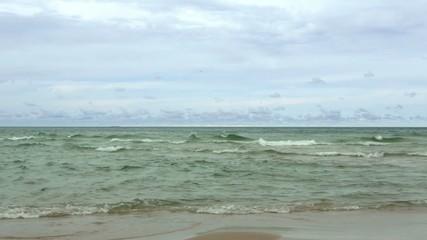 Pan across the Michigan shoreline, looking at Lake Michigan, USA.