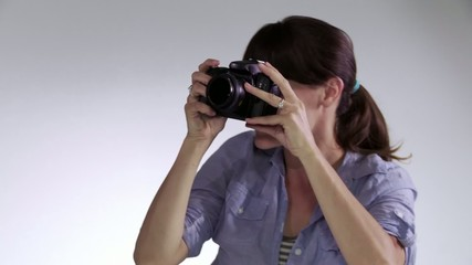Female photographer working with male model in studio, close up  Edgy, hand-held camera.