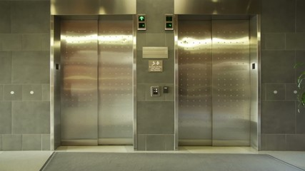 Empty elevator arrives, doors open and close.  Wide, locked off shot.
