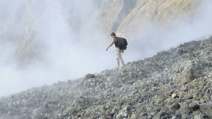 Man standing in active volcanic crater