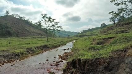 Hiking across tropical stream