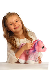 portrait of a girl playing with her toy pony
