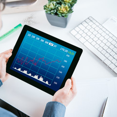 Businessman looking at a graph on his tablet