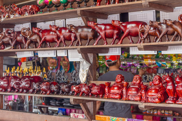 wooden crafted figurines in a souvenir shop, cambodia, siem reap