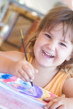 young happy child girl painting