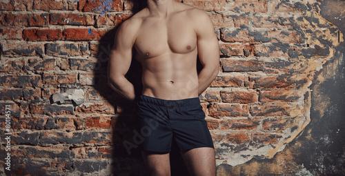 Leinwanddruck Bild Image of muscle man posing in studio