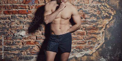 Poster Image of muscle man posing in studio