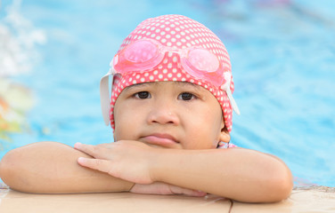 Little cute Asian girl bore to swimming