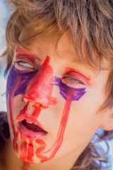 young kid - boy - with painted face, child zombie face art