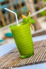 mango mint cocktail in outdoor restaurant, blurred background