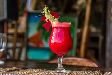 beetroot vegetable cocktail in outdoor restaurant, blurred backg