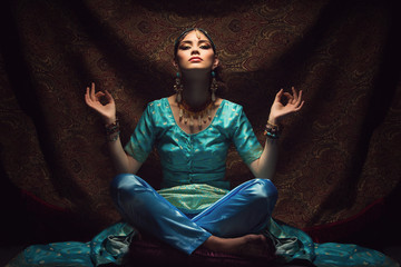 Girl sitting in lotus position
