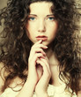 Image of beautiful young woman with curly hair