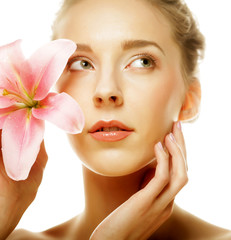 Beauty face of the young woman with pink lily