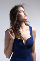 Woman in Blue Dress and Long Brown Hair Looking