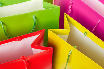 Colorful paper shopping bags background