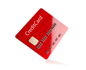 Credit card on white reflective surface.