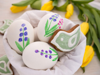 Painted Easter eggs and bird shaped cookies