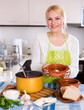 blonde in apron with meat