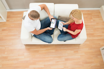 High View Of Couple With Digital Tablet