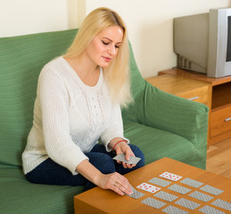 Woman with cards in home interior