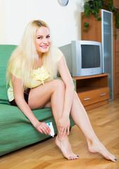 Woman treating foot callosity
