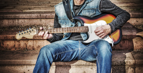guitarist with a colorful electric guitar in hdr