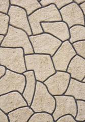 Rough plaster imitation stones on wall
