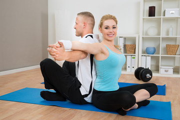Young Couple Stretching Hands