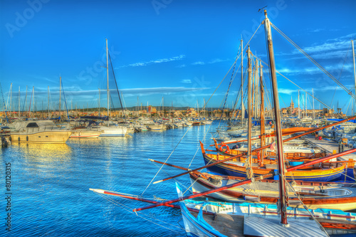 boats in Alghero harbor at sunset - 80120315