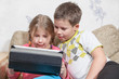 Preschool children playing tablet pc together