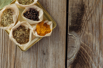 Herbs and spices on wooden table top view