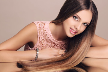 beautiful young smiling woman with dark straight hair