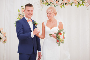 The bride and groom wear a ring