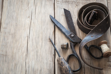 Homemade vintage tools on a wooden background with space for tex