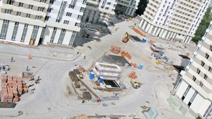 Builders go on building site of housing estate, time lapse