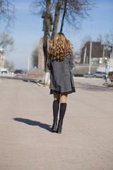 Young beautiful girl in a gray coat