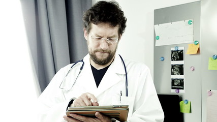 Doctor working with tablet ipad in hospital