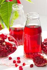 Ripe Red Pomegranates and Fresh Juice