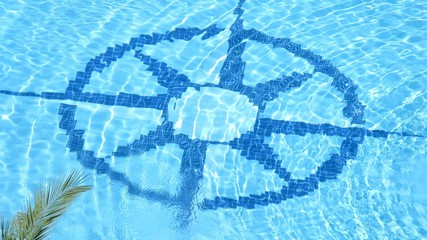 Sign Compass card laid out by tile in pool, time lapse