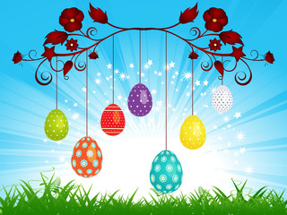 Dangling Easter eggs on blue sky landscape