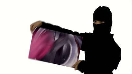 Young ninja assassin spins a moving image of soap suds and it magically transforms into clothes tumble drying.  It's ninja-laundry-tastic.