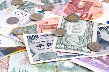 Money from different countries closeup with euro coins